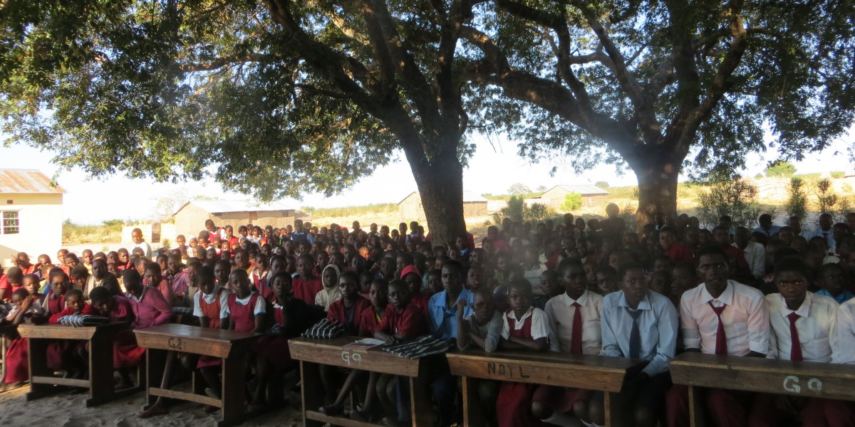 IMG_0003 Pupils listening to the facilitator during hygiene and sanitation training at Liliachi school.